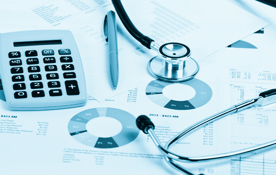 healthcare CPAs services with calculator and paperwork