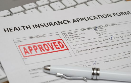 health insurance application form with approved stamp