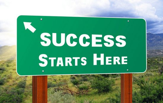 road sign reading success starts here