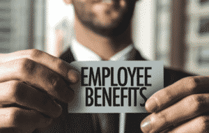 "employee holding card that says ""employee benefits"""