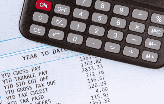 calculator with list of payroll tax withholding amounts