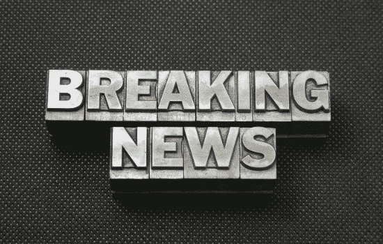 """BREAKING NEWS"" in silver typeface against black background"