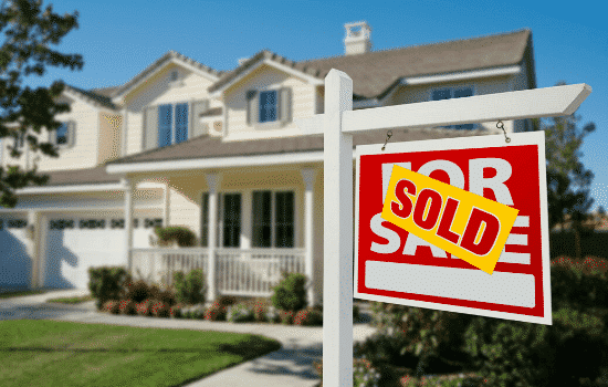 home with sold sign out front
