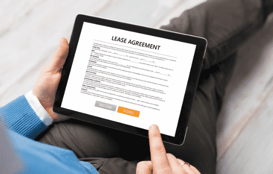 person reviewing lease options on lease agreement