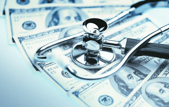 money under stethoscope with blue filter