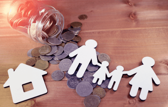 Cut-out of family sitting on coins
