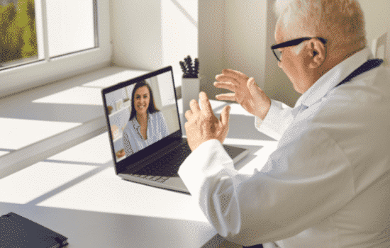 doctor speaks with patient through telehealth